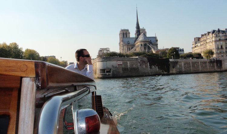 View of Notre Dame Cathedral from the back during a private Luxury Boat Cruise on the Seine River